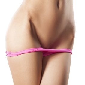 a woman with her half panties showing her waxed pubic area